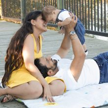 Young mother and father with baby smiling photo by Candice Vera Photography - lifestyle and family photography