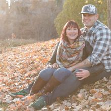 man and woman sitting together in the fall leaves smiling photo by Candice Vera Photography - Lifestyle and Family Photography