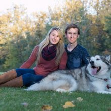 young couple sitting on grass with their dog photo by Candice Vera Photography - Lifestyle and Family Photography