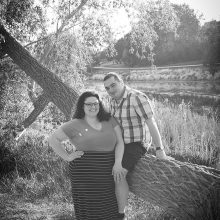 Engaged couple sitting on a tree branch photo by Candice Vera Photography - Weddings and Engagements Photography