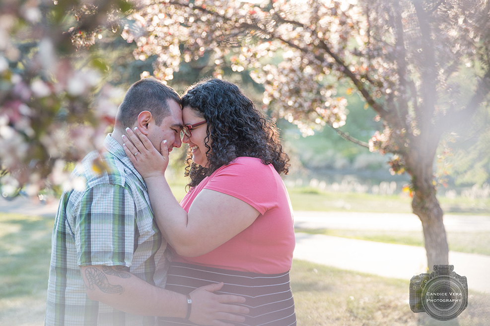 Engaged couple holding each other photo by Candice Vera Photography - Weddings and Engagements Photography
