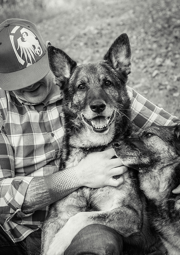 Man hugging his dogs photo by Candice Vera Photography - Lifestyle and Family Photography