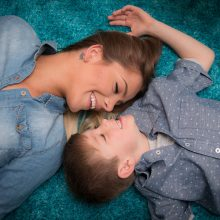 Mother and son laying on floor smiling at each other photo by Candice Vera Photography - Lifestyle and Family Photography