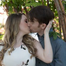 young engaged couple kissing in the trees photo by Candice Vera Photography - Weddings and Engagements Photography