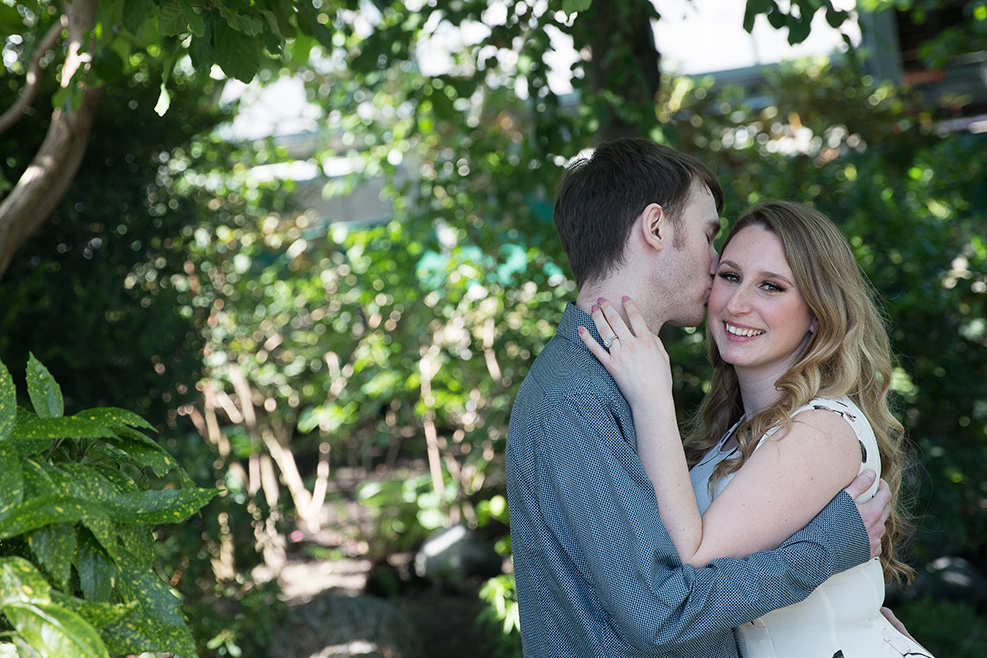 young man kissing his fiance photo by Candice Vera Photography - Weddings and Engagements Photography