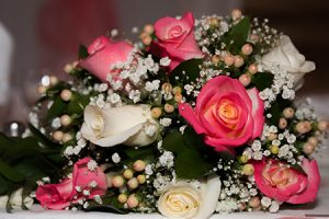 Bridal bouquet of white and pink roses photo by Candice Vera Photography
