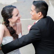 Bride and groom smile and look into each others eyes photographed by Candice Vera Photography